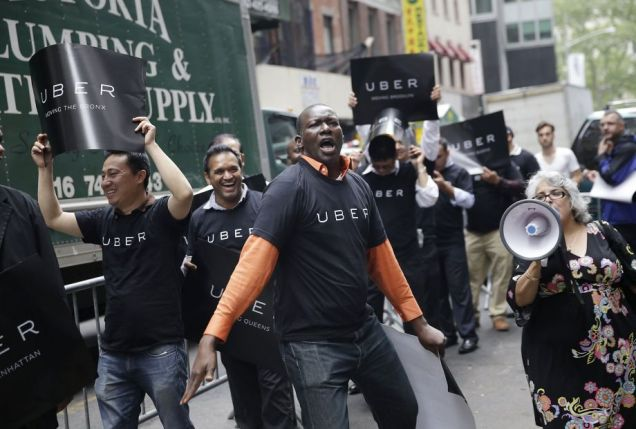 In this May 2015 file photo, Uber drivers and their supporters protest in front of the offices of the Taxi and Limousine Commission in New York . Photo: Seth Wenig, Associated Press